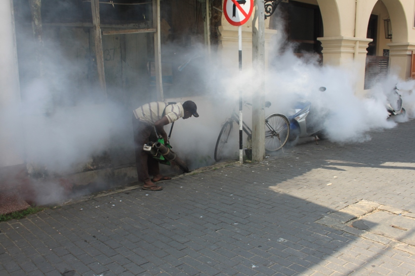 Fumigating the drains, Galle